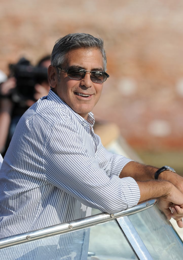 George Clooney on a boat in Venice.