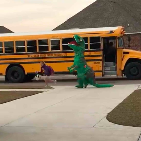 Dad Gets Daughter From Bus in Dinosaur Costume