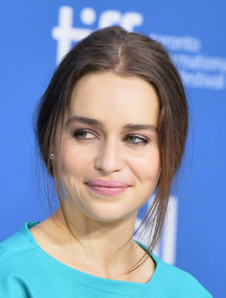 At the press conference for Dom Hemingway, Emilia Clarke went with a soft makeup look and face-framing tendrils.