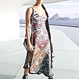 Alicia attended the Louis Vuitton Cruise show in a patterned midi dress from the label and chunky platform boots.