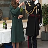 The Duke and Duchess of Cambridge enjoyed a drink during the St. Patrick's Day parade in Aldershot, England.