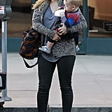Hilary Duff carried her son, Luca, across the street.