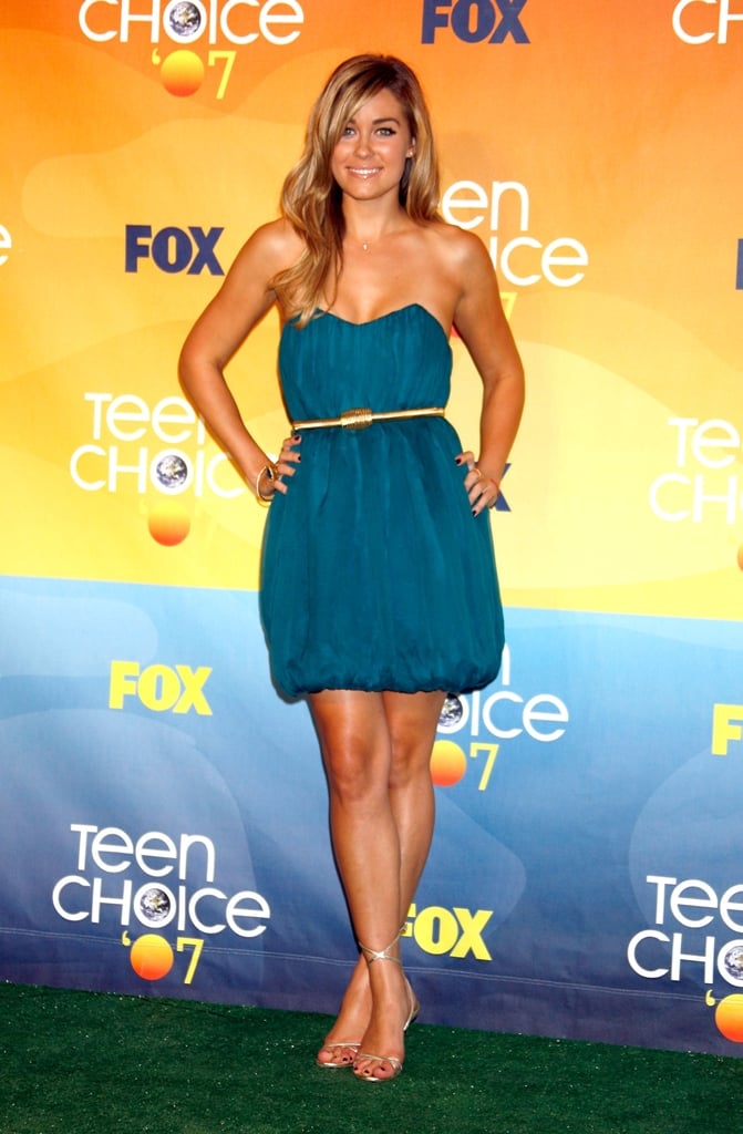 LC glowed in a strapless, teal bubble dress, designed by Conrad herself, at the 2007 Teen Choice Awards. Lesson from Lauren: teal complements every skin tone.