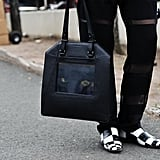 A Sydney Rogers bag that's played up by black-and-white squares.