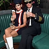 Cindy Crawford and Randy Gerber as a Flight Attendant and Pilot