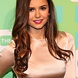 Nina Dobrev wore her long locks down for the event.