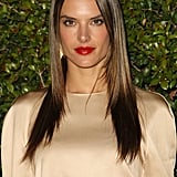 The golden highlights in Alessandra Ambrosio's hair picked up the champagne shade of her top, and the red lipstick was the cherry on top.
