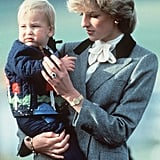 Princess Diana lovingly held Prince William as they arrived at Aberdeen airport in Scotland in 1983.