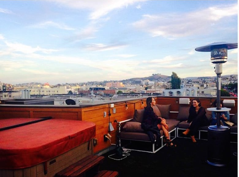 Have drinks at a rooftop bar.