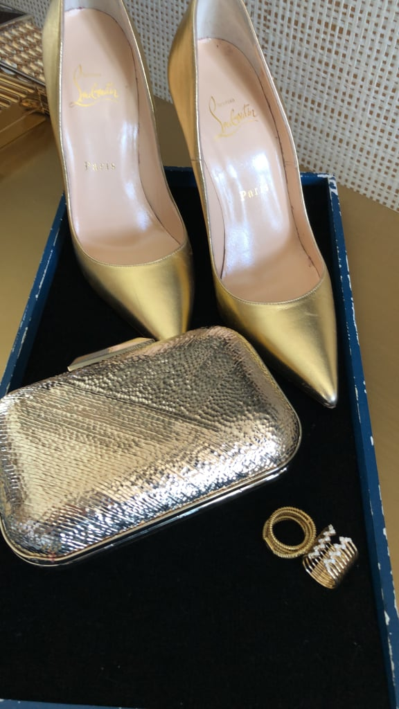 cheaper f4aac 5a9b5 Olivia's Accessories Include Gold Christian Louboutin ...