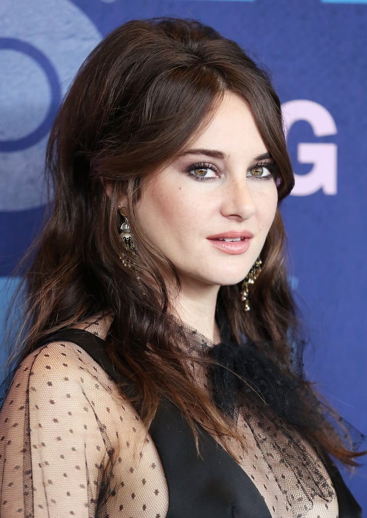 Shailene Woodley may have been attending the Big Little Lies season two premiere on May 29, 2019, but her beauty look placed her smack in the '60s. Wearing a bodysuit and sheer dress by Dior, the actress went with a glamorous look reminiscent of Brigitte Bardot and other screen sirens of her time.  For her hair, stylist Keith Carpenter teased Shailene's hair at the back and gave her the effect of on-trend curtain bangs. Makeup artist Tyron Machhausen, meanwhile, used Chanel products to create a sexy smoky eye, bronzed cheeks, and a peachy nude lip. See photos from Shailene's lovely retro red carpet appearance ahead, and shop the exact products that went into her makeup look.      Related:                                                                                                           5 Hairstyles That Will Be Scorching Hot This Summer