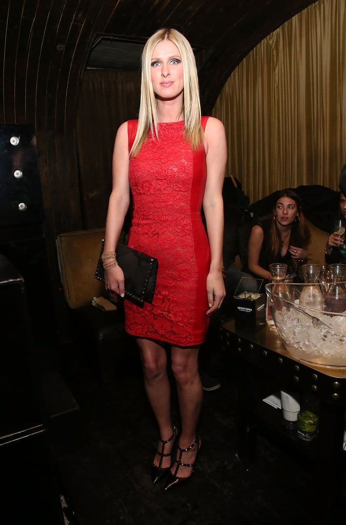 Nicky Hilton amped up her classic little red dress with ladylike lace, studded Valentino pumps, and matching clutch at the Charlotte Ronson afterparty.