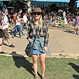 We loved the way this festivalgoer styled her of-the-moment denim skirt with a floaty top and chic hat.