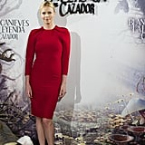 Charlize Theron opted for a red Giambattista Valli sheath dress paired with nude Christian Louboutin pumps to the Madrid photocall of Snow White and the Huntsman.