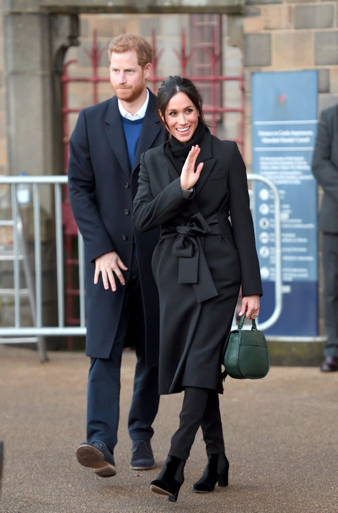 Meghan stepped out in Cardiff, Wales, in yet another all-black outfit in January 2018. The then bride-to-be wore a fabulous belted Stella McCartney coat, a scarf, Huit Denim trousers, and velvet Tabitha Simmons boots. She finished off her look with a green DeMellier handbag.