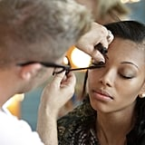 Makeup artists worked on Bianca before her shoot.  Photo courtesy of The CW