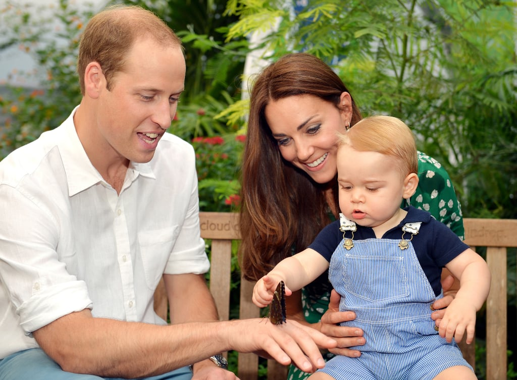 """Look at him go! Kate Middleton and Prince William shared Prince George's new official portrait with the world on Saturday, and today they revealed two more. Wearing seersucker overalls and a blue polo, little George is pictured walking with his arms up and focusing on a butterfly alongside his parents in others. The adorable moments were captured at the Sensational Butterflies exhibition at London's Natural History Museum, which the family visited in June. As is typically the case for the English royals, official portraits of George commemorate milestones. His last portrait was released in March before George's first royal tour, and this latest image comes just four days before the royal baby's first birthday, which is on Tuesday. William and Kate also shared a statement to mark the occasion: """"We would like to take this opportunity on George's first birthday to thank everyone over the last year, wherever we have met them, both at home and overseas, for their warm and generous good wishes to George and our family."""" The new picture marks the first time we've caught a glimpse of George since Father's Day, when he crawled at Prince William's polo match. Although we haven't seen much of George in recent months, the royal family has revealed a lot about him in the past year. Earlier this month, William opened up about the family's morning routine, saying he listens to the radio while feeding George."""