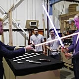 Harry and William dueled each other with lightsabers while visiting the Star Wars set at England's Pinewood Studios in April.