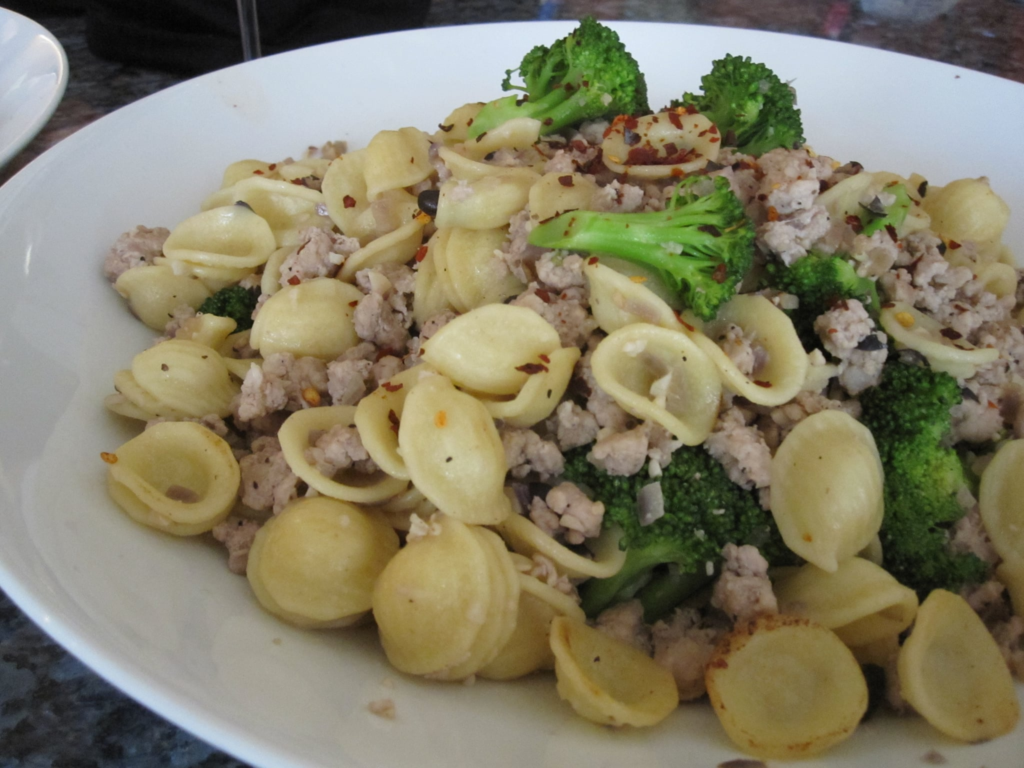 This plate of pasta was created by Ming Tsai. First he cooks the pasta, then he drains it, and sets it aside while he makes the sausage, black bean, and broccoli sauce. It's an interesting technique for only dirtying one pot.