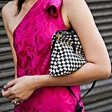 A vintage Bottega Venetta clutch popped against a pretty fuchsia dress.