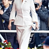 Her White Suit Is a Step Above the Rest With Its Subtle Bell Sleeves