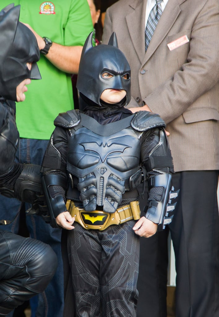 Batkid talked strategy with Batman after Lou Seal was kidnapped.