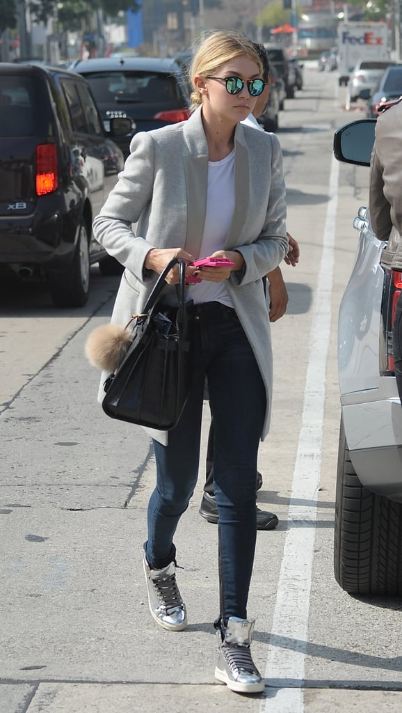 She reworked a rocker tee with a grey coat for downtime in Beverly Hills.