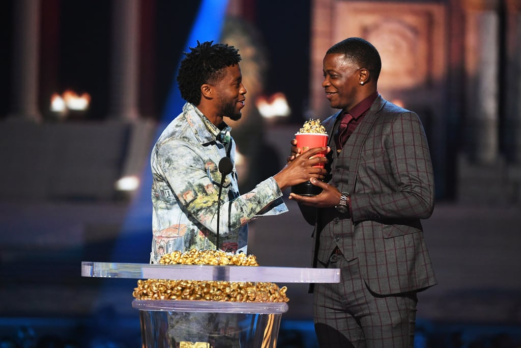 "When Black Panther star Chadwick Boseman accepted the award for best hero at this year's MTV Movie & TV Awards, he took the opportunity to share his award with a ""real-life"" hero instead. ""Receiving an award for playing a superhero is amazing, but it's even greater to acknowledge the heroes that we have in real life,"" he said. ""I just want to acknowledge somebody that's here today: James Shaw Jr. If you don't know James Shaw Jr., he fought off a gunman in Antioch, TN, at a Waffle House. He saved lives."" The actor surprised James by inviting him on stage, and he got emotional as he held up his award and told James, ""This is going to live at your house."" James Shaw Jr. made headlines earlier this year when he rushed a shooter at a Waffle House, intervening after shots were fired to save lives. At a press conference following the shooting, he insisted he wasn't a hero. ""I'm just a regular person,"" he said. ""You have to either react or you're going to fold, and I chose to react because I didn't see any other way of living, and that's all I wanted to do. I just wanted to live."" Following the MTV Movie & TV Awards, Chadwick took to Twitter to acknowledge James again. ""I was honored to meet @JamesShawJr9. He saved countless lives by tackling a gunman who opened fire on people in Antioch, Tennessee in April,"" he wrote, adding, ""He's a true hero that walks among us."" Keep reading to watch the touching moment, then see more snaps of the Black Panther cast's special night."