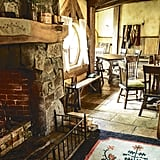 The Green Dragon Inn is like a cozy and traditional English gathering spot.