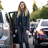 The perfect look for running errands: a dark-wash denim jacket and jeans, a t-shirt, and sneakers.