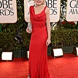 The Newsroom's Alison Pill matched the red carpet in her asymmetrical cowl-necked gown.
