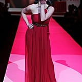 Kim Kardashian blew a kiss to showgoers as she walked the runway for Heart Truth's Red Dress Collection show during New York Fashion Week in February 2010.