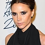 Victoria Beckham went for a sleek black look at the British Fashion Awards.