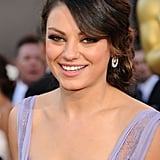 At the Academy Awards later that year, Mila opted for a more ethereal beauty look. With her twisted chignon and petal-pink lipstick, Mila was full-on feminine.