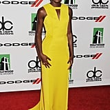 Lupita Nyong'o made her presence known on the red carpet at the 17th Annual Hollywood Film Awards in a vivacious citrus J. Mendel gown featuring a sharp keyhole. The actress finished her look with Monique Péan jewelry.