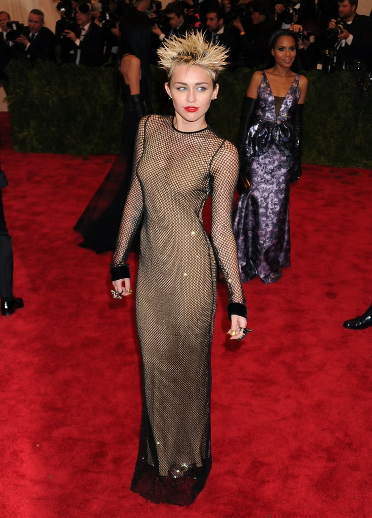 On May 6, Miley Cyrus let her punk flag fly when she attended the 2013 Met Gala for its Punk: Chaos to Couture exhibit. She was decked out in a fishnet Marc Jacobs dress and spiked her blond hair into a Sid Vicious 'do.