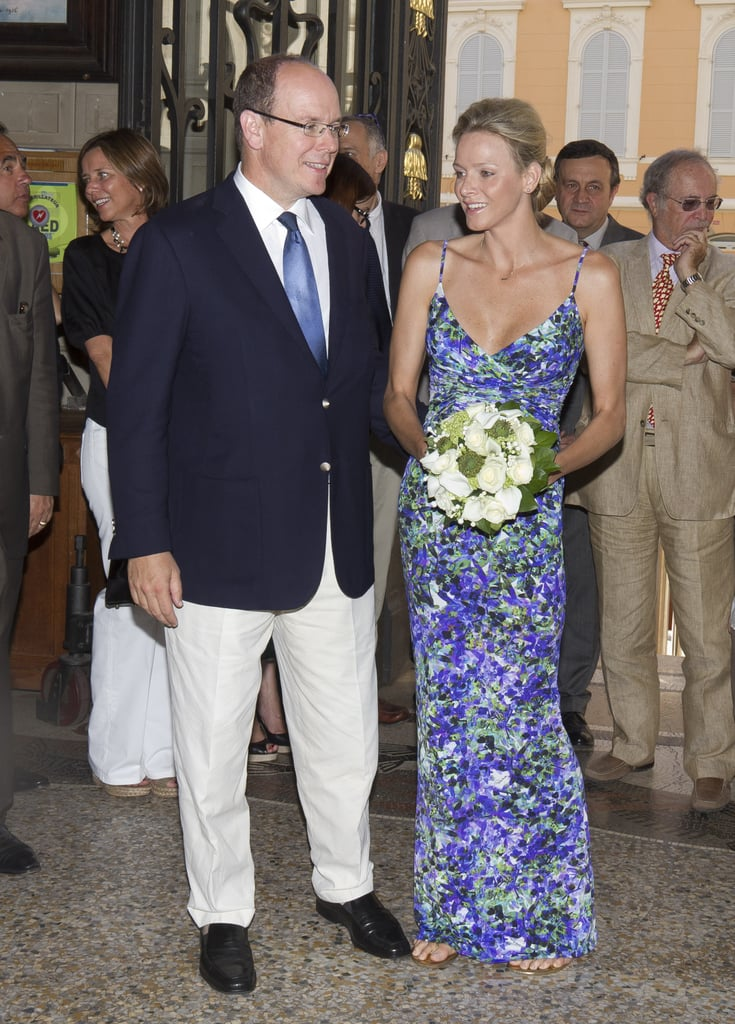 """The Prince and Princess of Monaco, who wore a Roberto Cavalli dress, made an appearance near home at the Oceanographic Museum yesterday to check out a new exhibit, which is devoted to their wedding. """"The Story of the Prince's Wedding"""" features Charlene Wittstock's Giorgio Armani gown, the white uniform that Prince Albert wore, place settings from their reception, and other items from the July event. Charlene and Prince Albert have faced some controversy since their nuptials, with rumors that they spent their honeymoon in separate hotels. Prince Albert and Charlene defended their marriage recently and struck back at all the press coverage. They seemed to be in good spirits as they walked through the museum and posed in front of a large picture of themselves as bride and groom. Theirs isn't the only royal wedding on display since items from Kate Middleton and Prince William's nuptials are currently being shown at Buckingham Palace in London. Kate Middleton and the Queen toured the Summer exhibit and took a look at Kate's gorgeous gown as well as the heels she wore when she wed Prince William."""