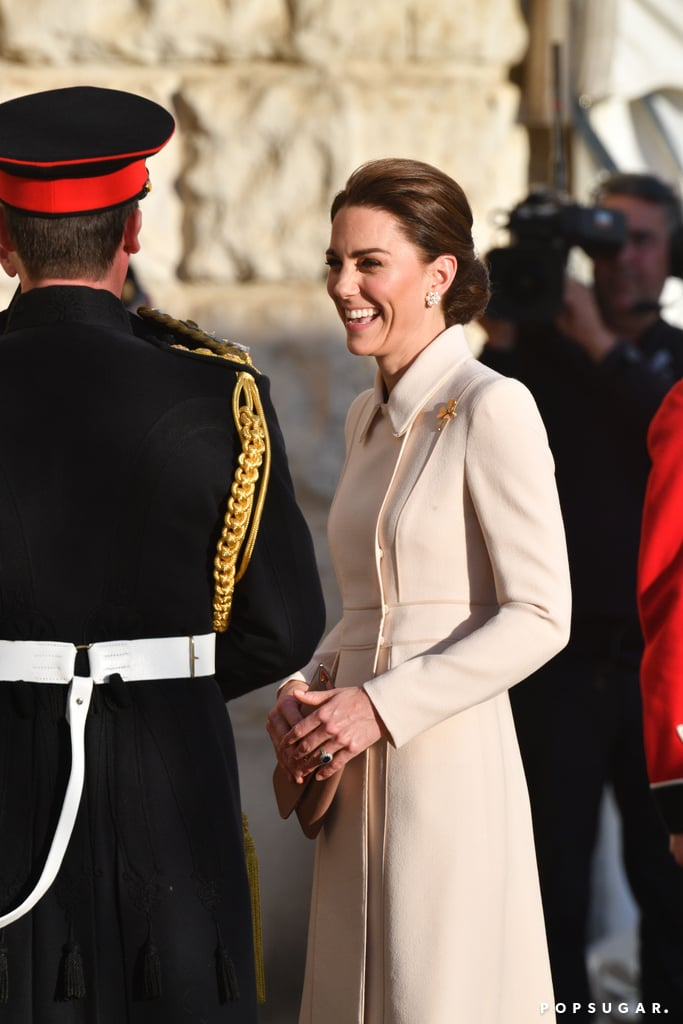 The Duchess of Cambridge was all smiles as she attended the Beating Retreat Ceremony in London on Thursday afternoon. The royal donned a cream coat and nude heels as she stepped out for the military event. The Duchess of Cambridge has certainly been keeping busy this week. In addition to getting all dolled up for the queen's state banquet on Monday, she is set to appear alongside the rest of the royal family for Trooping the Colour on Saturday. In fact, Kate and Prince William's youngest son, Prince Louis, is reportedly making his royal debut at the annual ceremony.       Related:                                                                                                           Kate Middleton Is Hitting the Ground Running in 2019 — See Her Best Moments So Far