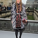 Anna Dello Russo doubled up on fur with a black and blue vest and colorblocked handbag at Christian Dior.