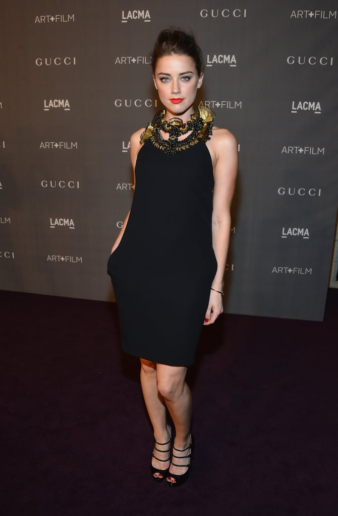 Amber Heard opted for a Gucci LBD with a dramatic, gold and black beaded neckline.