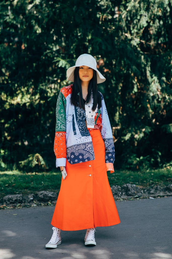 There's nothing we don't love about bold summer colors and a dress paired with sneakers.