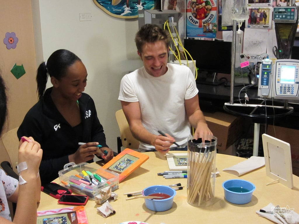 Robert Pattinson joked around with one of the girls during his visit to the children's hospital in LA. Source: Flickr user Children's Hospital Los Angeles