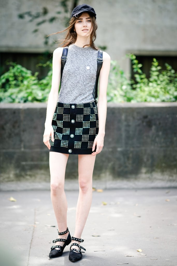 Wear a Studded Miniskirt With a Gray Tank Top and Newsboy Cap