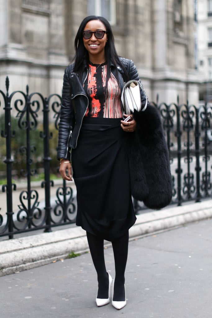Shiona Turini added interest to a wrap skirt and heels with an abstract top and quilted leather jacket.