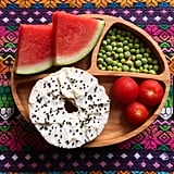 """""""Lunch: watermelon, sugar snap pea pods, cherry tomatoes, and an everything bagel with cream cheese and black sesame seeds."""""""