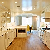 No expense was spared in the gourmet kitchen. It was remodeled with custom cabinetry and top-of-the-line appliances like a La Cornue oven.