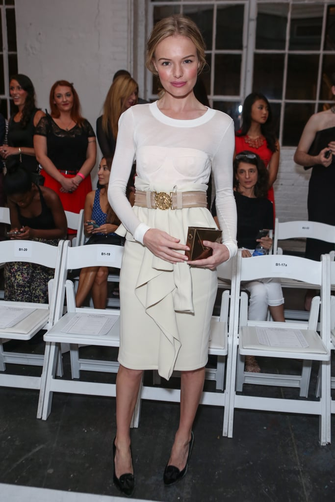 Kate was front row for Altuzarra's September 2012 runway show in a white long-sleeved dress that she cinched at the waist with a bold belt. She accessorised with a gold envelope clutch from JewelMint.