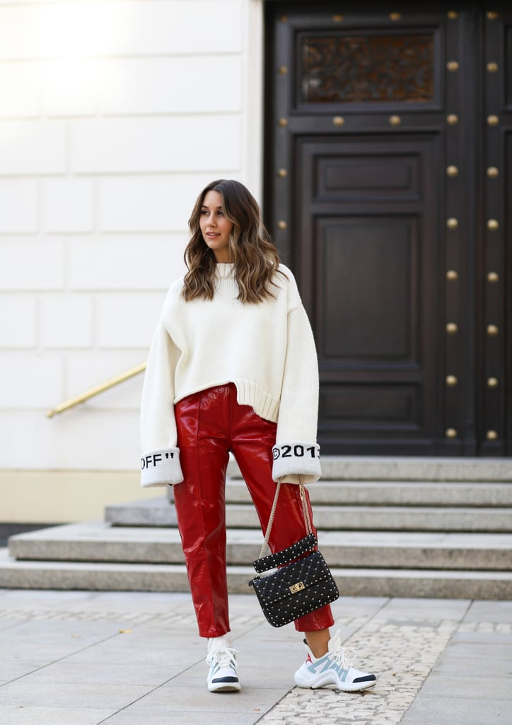 57cb5ddd42 Style an Oversized White Sweater With Bold Red Pants