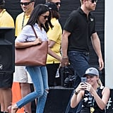 Meghan wore her exact Misha Nonoo husband shirt at the Invictus Games with Prince Harry, styled with Mother Denim skinny jeans, Sarah Flint bow flats, and an Everlane tote.