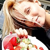 Natasha Poly enjoyed a bowl of strawberries in the sun. Source: Instagram user natashapoly